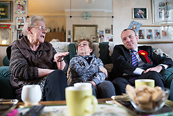 © Licensed to London News Pictures . 30/01/2014. Manchester, UK. L-R June Birds (74 , local pensioner) , Dee Amesbury and Mike Kane . Shadow Secretary of State for Energy and Climate Change , Caroline Flint MP , with PPC Mike Kane in the home of pensioners Dee (82) and Ted (88) Amesbury ahead of the Wythenshawe and Sale East by-election . Photo credit : Joel Goodman/LNP