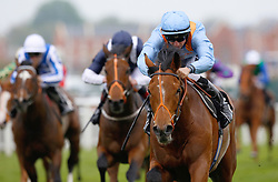 Raymond Tusk and Tom Marquand win Division II of The Dubai Duty Free Tennis Championships Maiden Stakes Race run during Dubai Duty Free Spring Trials Saturday at Newbury Racecourse.