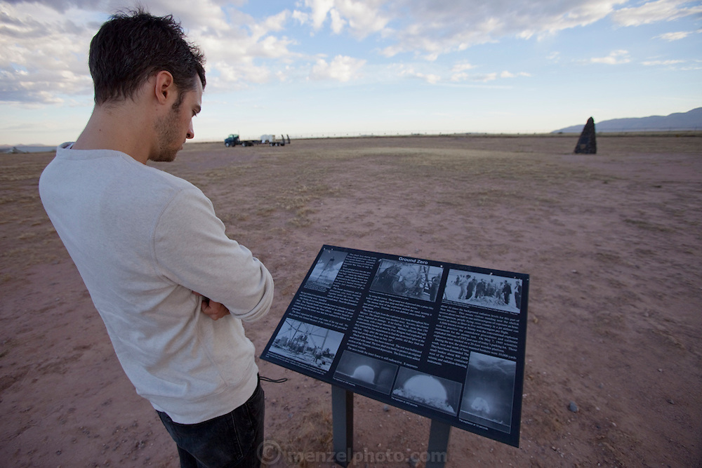"Evan Menzel at Site Trinity, ground zero, on the White Sands Missile Range in S. New Mexico. Site of the world's first atomic explosion n July 16, 1945. The atomic bomb was developed by the Manhatten Project. The Manhattan Project refers to the effort during World War II by the United States, in collaboration with the United Kingdom, Canada, and other European physicists, to develop the first nuclear weapons. Formally designated as the Manhattan Engineering District (MED), it refers specifically to the period of the project from 1942-1946 under the control of the U.S. Army Corps of Engineers, under the administration of General Leslie R. Groves, with its scientific research directed by the American physicist J. Robert Oppenheimer. The project succeeded in developing and detonating three nuclear weapons in 1945: a test detonation on July 16 (the Trinity test) near Alamogordo, New Mexico; an enriched uranium bomb code-named ""Little Boy"" detonated on August 6 over Hiroshima, Japan; and a plutonium bomb code-named ""Fat Man"" on August 9 over Nagasaki, Japan. (http://en.wikipedia.org/wiki/Manhattan_Project) MODEL RELEASED."