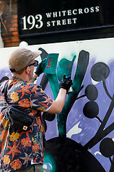 © Licensed to London News Pictures. 11/09/2021. LONDON, UK.  London, UK.  11 September 2021. Street artist Matt Sewell at work as people enjoy the return of the annual Whitecross Street Party in Whitecross Street near Barbican for the weekend.  As well as performance and community events, several street artists are painting live for The Rise of the Nonconformists outdoor exhibition.  Since 2010, the event has paid homage to prominent nonconformists William Blake, Daniel Defoe, John Bunyan and Susannah Wesley who were laid to rest in nearby Bunhill Fields Burial Ground. .  Photo credit: Stephen Chung/LNP