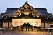 two young people praying at the Yasukuni Shrine Tokyo Japan