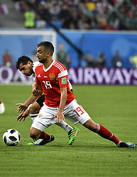 SAINT PETERSBURG, June 19, 2018  Tarek Hamed (L) of Egypt vies with Alexandr Samedov of Russia during a Group A match between Russia and Egypt at the 2018 FIFA World Cup in Saint Petersburg, Russia, June 19, 2018. (Credit Image: © Chen Yichen/Xinhua via ZUMA Wire)