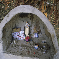 A trailside shrine blesses people walking or riding along a trail above the Apurimac River in the Cordillera Vilcabamba, Peru.