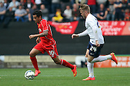 Liverpool's Philippe Coutinho breaks away from Preston North End's Will Hayhurst. pre-season friendly match, Preston North End v Liverpool at Deepdale in Preston, England on Saturday 19th July 2014.<br /> pic by Chris Stading, Andrew Orchard sports photography.