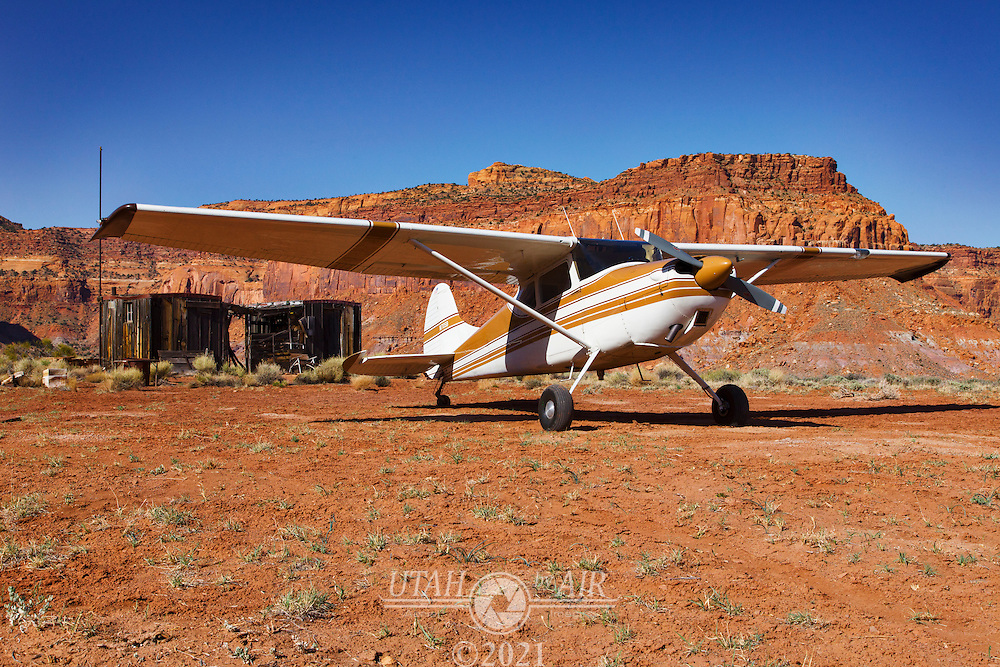 Parked at the Happy Canyon airstrip. There are two crossing runways, but the North-South runway needs work to be usable. Land uphill to the East.