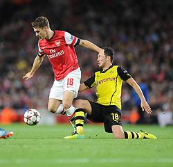 Borrusia Dortmund's Nuri Sahin tackles  Arsenal's Aaron Ramsey- Photo mandatory by-line: Alex James/JMP - Tel: Mobile: 07966 386802 22/10/2013 - SPORT - FOOTBALL - Emirates Stadium - London - Arsenal v Borussia Dortmund - CHAMPIONS LEAGUE - GROUP F