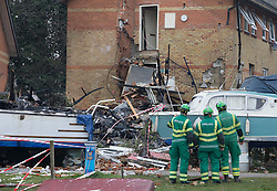 © Licensed to London News Pictures. 15/02/2017. Oxford, UK. Ambulance medics look at the remains of a block of flats damaged in an explosion near Osney Lock in Oxford. A number of people have been injured in what is thought to have been a gas explosion. Photo credit: Peter Macdiarmid/LNP