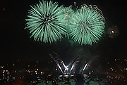 Green fireworks explode over Lake Union on the Fourth of July.<br />