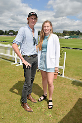 JACK TAYLOR and TABBY TAYLOR at the Jaeger-LeCoultre Gold Cup Polo Final held at Cowdray Park Polo Club, Midhurst, West Sussex on 19th July 2015