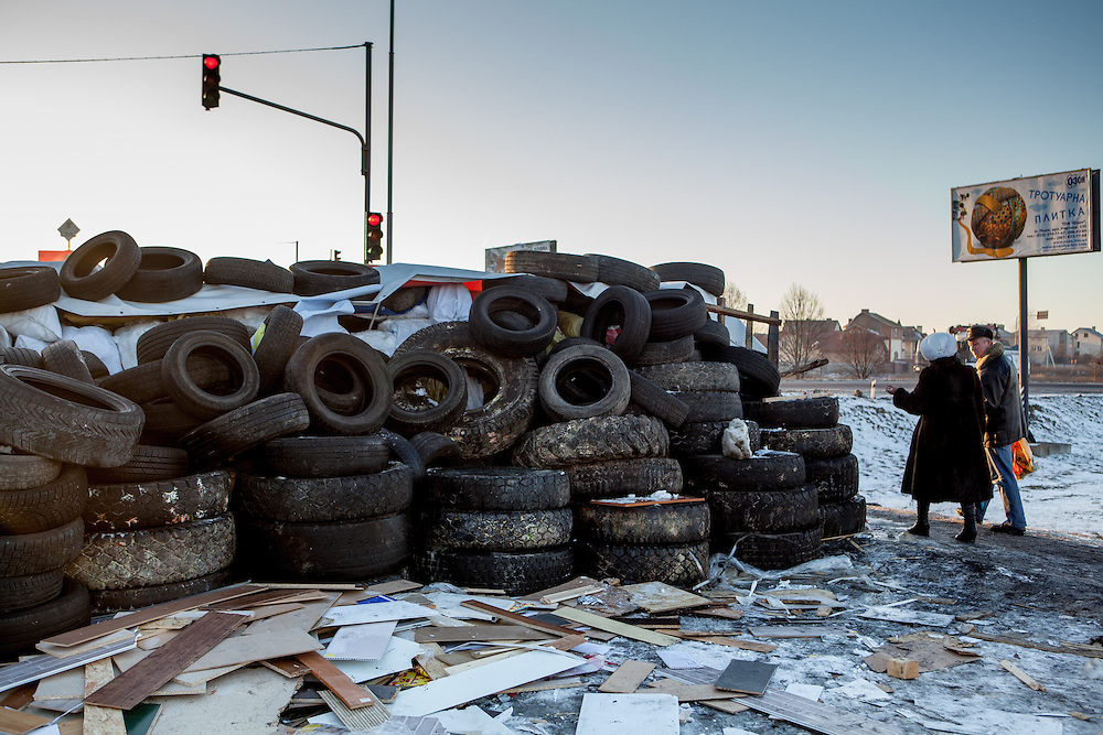 """View from behind the barricades blockading a building supplies store named """"Epicenter"""" in the city of Lviv, Ukraine."""