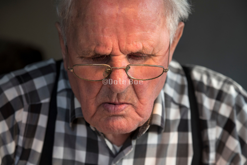 portrait of an 94 year old man while reading