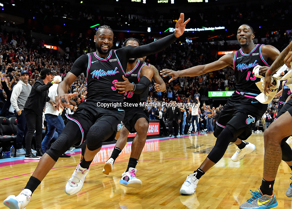 Feb 27, 2019; Miami, FL, USA; Miami Heat guard Dwyane Wade (3) celebrates after making the game winning basket against the Golden State Warriors during the second half at American Airlines Arena. Mandatory Credit: Steve Mitchell