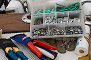 Plastic tray of terminal tackle - crimps, sleeves, and chaff gear.
