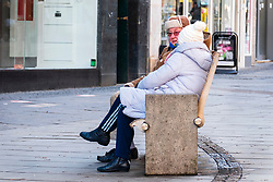An old couple take a seat in Fargate Sheffield as the third national UK lockdown comes into effect <br /> <br /> 05 January 2020<br /> <br /> www.pauldaviddrabble.co.uk<br /> All Images Copyright Paul David Drabble - <br /> All rights Reserved - <br /> Moral Rights Asserted -