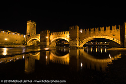 The Castel Vecchio Bridge, which is also known as the Scaliger Bridge, is actually a faithful reconstruction of the original 1300's bridge after it was destroyed by retreating German troops on April 24, 1945. Verona, Italy after Motor Bike Expo. Monday January 22, 2018. Photography ©2018 Michael Lichter.z