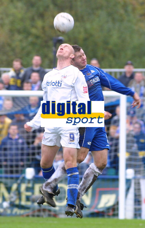 Photo: Dave Linney.<br />Chasetown v Oldham Athletic. The FA Cup. 06/11/2005.<br />Luke Beckett(Oldham) in an aerial dual with Kevi Thompson(Chasetown)