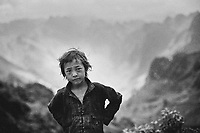 A young child along the road in Ha Giang, Vietnam.