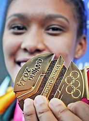 Cape Town - 140831 - Gezelle Magerman received a hero's welcome at the Cape Town International Airport. She won South Africa's first medal of the 2014 Youth Olympic Games, taking gold in the women's 400m hurdles in Nanjing, China. Reporter: Kieran Legg Picture: David Ritchie (083 652 4951)