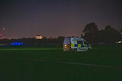 © Licensed to London News Pictures. 01/06/2021. London, UK. Police vehicles form a cordon following a stabbing in Hyde Park. Photo credit: Peter Manning/LNP