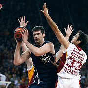 Anadolu Efes's Stanko Barac (L) during their Euroleague Top 16 basketball match Galatasaray MP between Anadolu Efes at the Abdi Ipekci Arena in Istanbul at Turkey on Wednesday, February, 22, 2012. Photo by TURKPIX