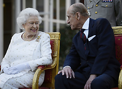 File photo dated 05/06/14 of Queen Elizabeth II and the Duke of Edinburgh attending a garden party in Paris, hosted by Sir Peter Ricketts, Britain's Ambassador to France ahead of marking the 70th anniversary of the D-Day landings during World War II. He was the QueenÕs husband and the royal family's patriarch, but what will the Duke of Edinburgh be remembered for? Issue date: Friday April 4, 2021.