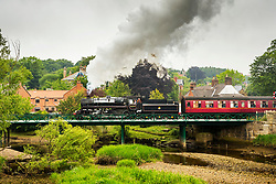 "© Licensed to London News Pictures. 28/05/2018. Ruswarp UK. Locomotive 76079 BR Standard known as the ""pocket rocket"" crosses the river Esk in the picturesque village of Ruswarp in the Yorkshire moors today on route from Whitby to Pickering. Photo credit: Andrew McCaren/LNP"