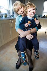 Boy sitting on his Grandmother's knee,