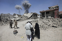 June 30, 2017 - Mosul, Iraq - A day after the Iraqi government declared the Islamic State (ISIS) was defeated in Mosul, heavy fighting persisted while newly liberated residents still fled the Old City neighborhood in droves. (Credit Image: © ZUMA Wire via ZUMA Wire)