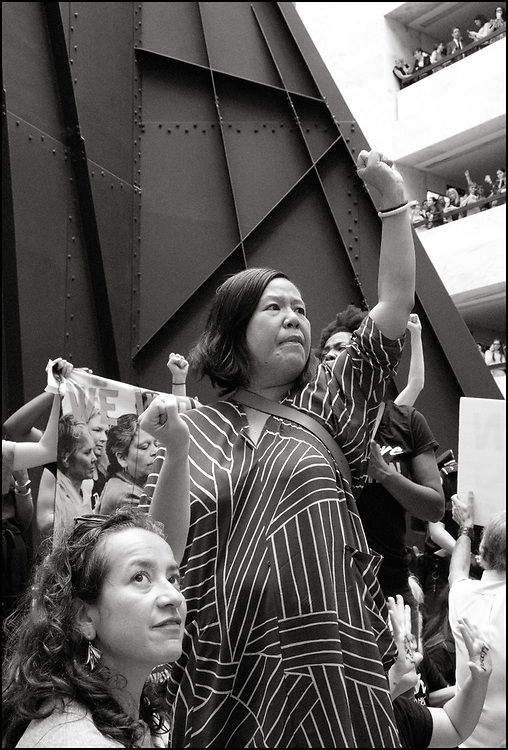 On October 4th, 2018 approximately 1000 people marched through Washing ton DC to protest the appointment, by President Donald trump, of Brett Kavanaugh, to the Supreme Court of the United States. <br /> <br /> The protesters marched from the federal courthouse to the Supreme Court to the Senate.  They were hoping to sway a handful of lawmakers considered swing votes in determining the fate of Kavanaugh after Christine Blasey Ford, accused the judge of sexually assaulting her at a high school party 36 years ago, a claim Kavanaugh denies. <br /> <br /> At least 300 people were arrested for sitting down in the atrium of the Hart Building and refusing to leave, including Ana Maria Archila Gualy, from the Center For Popular Democracy, and Winnie Wong, from The Women's March, pictured here.