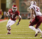 Nov 5, 2011; Fayetteville, AR, USA;  Arkansas Razorback wide receiver Jarius Wright (4) carries the ball as South Carolina Gamecocks safety DeVonte Holloman (21) looks on during a game at Donald W. Reynolds Stadium.  Mandatory Credit: Beth Hall-US PRESSWIRE