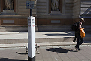 With a further 184 reported UK Covid deaths in the last 24 hrs, a total now of 43,414, a man walks with his dog outsie the Royal Academy on Burlington Gardens, on 26th June 2020, in London, England. Government restrictions are expected to ease for art galleries like the RA, with plans to re-open on 4th July. Venues reopening will be conditional on the progression of the virus and how well social distancing measures are implemented.