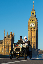 EDITORIAL USE ONLY Participants in the Bonhams London to Brighton Veteran Car Run pass Big Ben as they drive over Westminster Bridge in London.