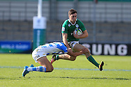 Conor O'Brien of Ireland breaks past Santiago Mare of Argentina (l). .World Rugby U20 Championship 2016,  Semi Final match,  Match 23  , Ireland U20's  v Argentina U20's at the Manchester city Academy Stadium in Manchester, Lancs on Monday 20th June 2016, pic by  Andrew Orchard, Andrew Orchard sports photography.
