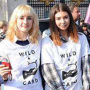 """Buckingham Palace, London, UK 9th October. 2021. Isobel Hadfield blonde (L) is a Co-founder of """"Wild Card"""" at the Wildlife campaigners and children are joined by tv presenter Chris Packham as they march to Buckingham Palace with a petition calling for the Royal Family to rewild their lands."""