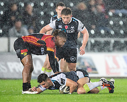 Tiaan Thomas-Wheeler of Ospreys under pressure from Howard Mnisi of Southern Kings<br /> <br /> Photographer Simon King/Replay Images<br /> <br /> Guinness PRO14 Round 6 - Ospreys v Southern Kings - Saturday 9th November 2019 - Liberty Stadium - Swansea<br /> <br /> World Copyright © Replay Images . All rights reserved. info@replayimages.co.uk - http://replayimages.co.uk