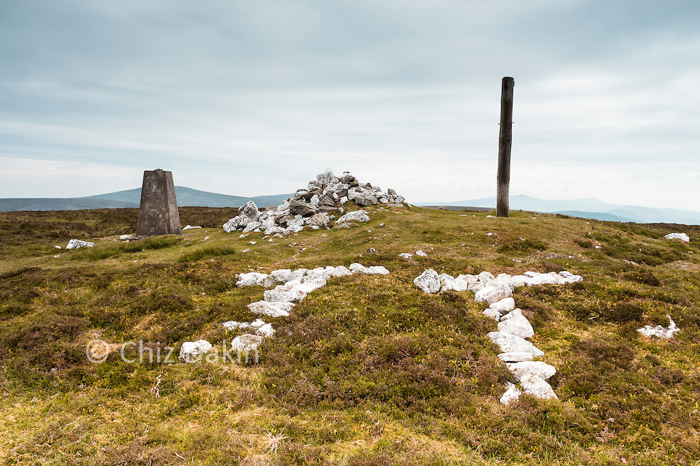 Cairn, trig point, pole... check - oh and TT stone letters. Must be the summit of Slieau Freoaghane then.