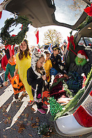 """Enter if you dare into the """"Christmas with the Grinch"""" by Julia Mairano and Kenneth Weinig as Grinch during Holy Trinity School's Trunk or Treat on Monday afternoon.  (Karen Bobotas/for the Laconia Daily Sun)"""