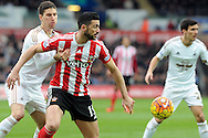 Southampton's Graziano Pelle (c) is challenged by Swansea's Federico Fernandez. Barclays Premier league match, Swansea city v Southampton at the Liberty Stadium in Swansea, South Wales on Saturday 13th February 2016.<br /> pic by  Carl Robertson, Andrew Orchard sports photography.