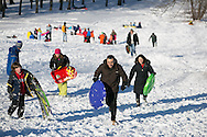Brookline, MA 02/10/2013<br /> Amir Taghavi, center, and Fatima Tousi, at right, came from Malden to try some sledding on the large hill at Larz Anderson Park on Sunday afternoon.