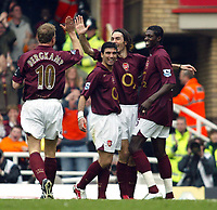 Photo: Chris Ratcliffe.<br />Arsenal v West Bromwich Albion. The Barclays Premiership. 15/04/2006.<br />Robert Pires of Arsenal celebrates his goal with Jose Antonio Reyes and Emmanuel Adebayor and gives Dennis Nergkamp the high five