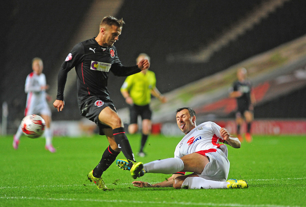 Fleetwood Town's David Ball is tackled by Milton Keynes Dons' Kyle McFadzean<br /> <br /> Photographer Chris Vaughan/CameraSport<br /> <br /> Football - The Football League Sky Bet League One - Milton Keynes Dons v Fleetwood Town - Tuesday 21st October 2014 - Stadium:mk - Milton Keynes<br /> <br /> © CameraSport - 43 Linden Ave. Countesthorpe. Leicester. England. LE8 5PG - Tel: +44 (0) 116 277 4147 - admin@camerasport.com - www.camerasport.com