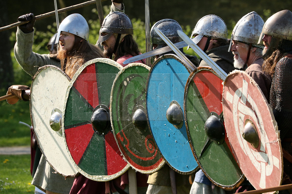 © Licensed to London News Pictures. 20/04/2019. Glastonbury, UK. Participants playing Viking Warriors, prepare to take the field of battle at Glastonbury Abbey Medieval Fayre on Easter bank holiday weekend.  Photo credit: Jason Bryant/LNP