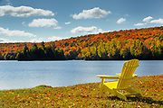 Muskoka chairs on shore of Silent Lake in autumn<br />Silent Lake Provincial Park<br />Ontario<br />Canada