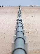 A pipeline running into the desert near Swakopmund, Namibia