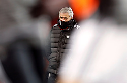 Manchester United manager Jose Mourinho on the pitch before the Emirates FA Cup, quarter final match at Old Trafford, Manchester