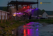 Stage lights reflect into Haskill Creek at the Under The Big Sky Music Festival in Whitefish, Montana, USA