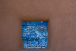 colorful window against an adobe wall in New Mexico