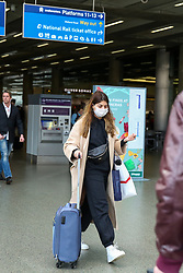 © Licensed to London News Pictures. 13/03/2020. London, UK. A women wearing a face mask leaves St Pancras International station. 798 cases have been tested positive and ten patients have died from the virus in the UK. Photo credit: Dinendra Haria/LNP