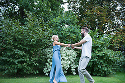 Young couple dancing together in garden, Bavaria, Germany
