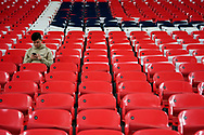 A fan sit alone during the International Friendly match between England and USA at Wembley Stadium, London, England on 15 November 2018.